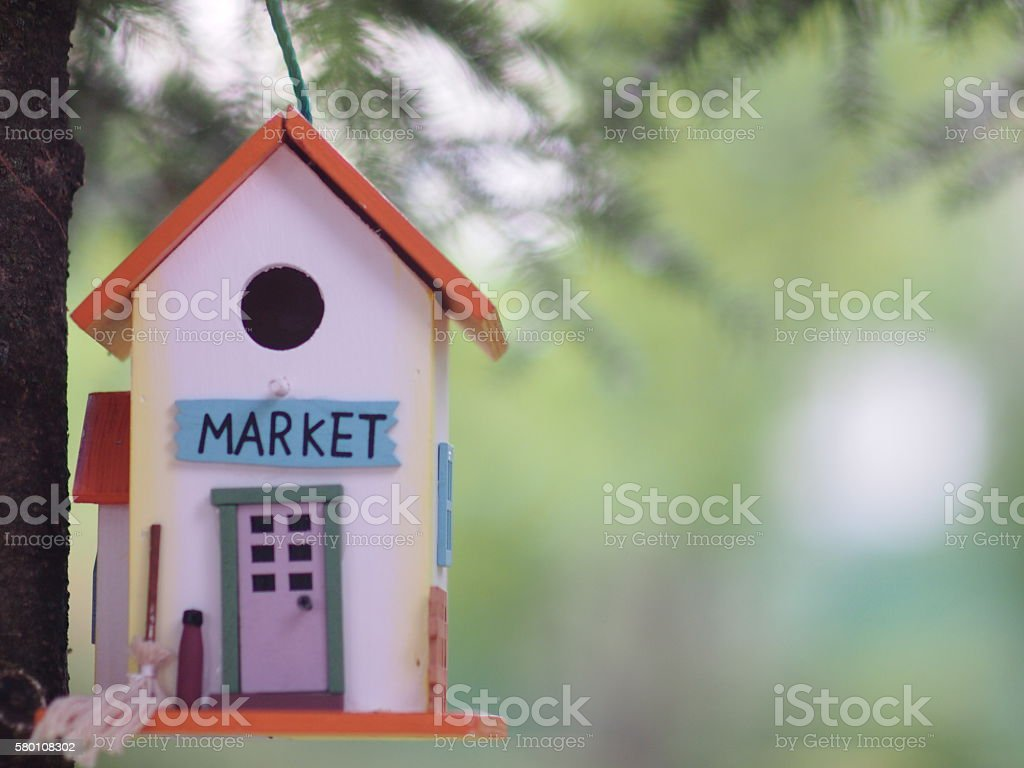 Tree house hanging from a branch stock photo