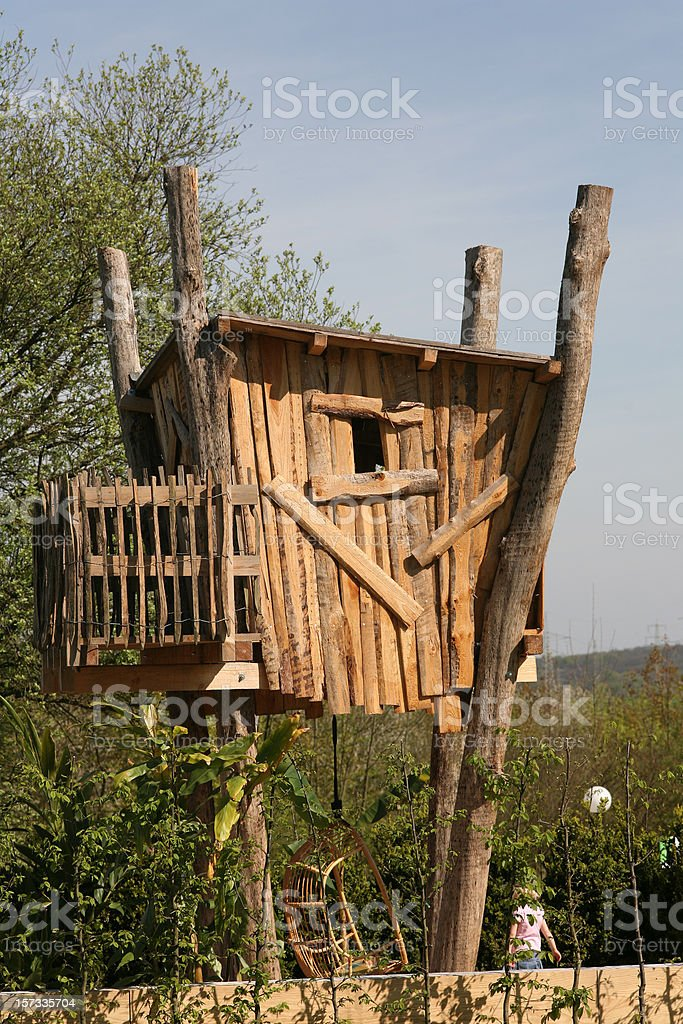 Tree house with rockingchair underneath royalty-free stock photo