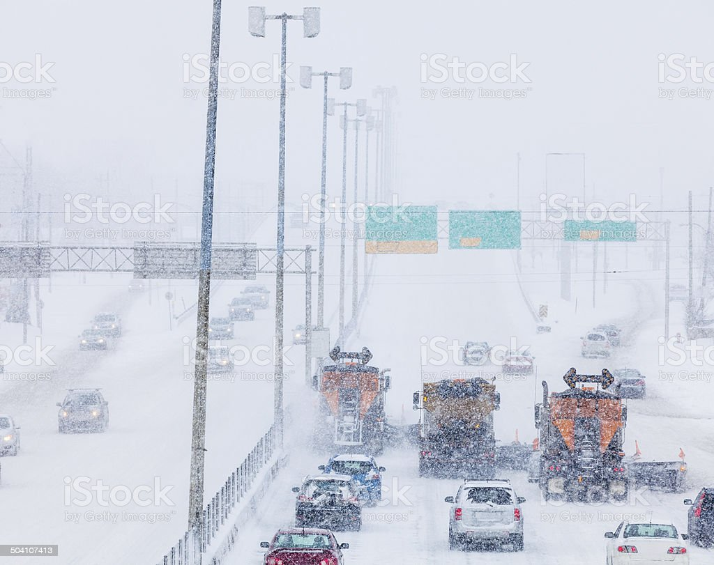 Tree Lined-up Snowplows Clearing the Highway stock photo