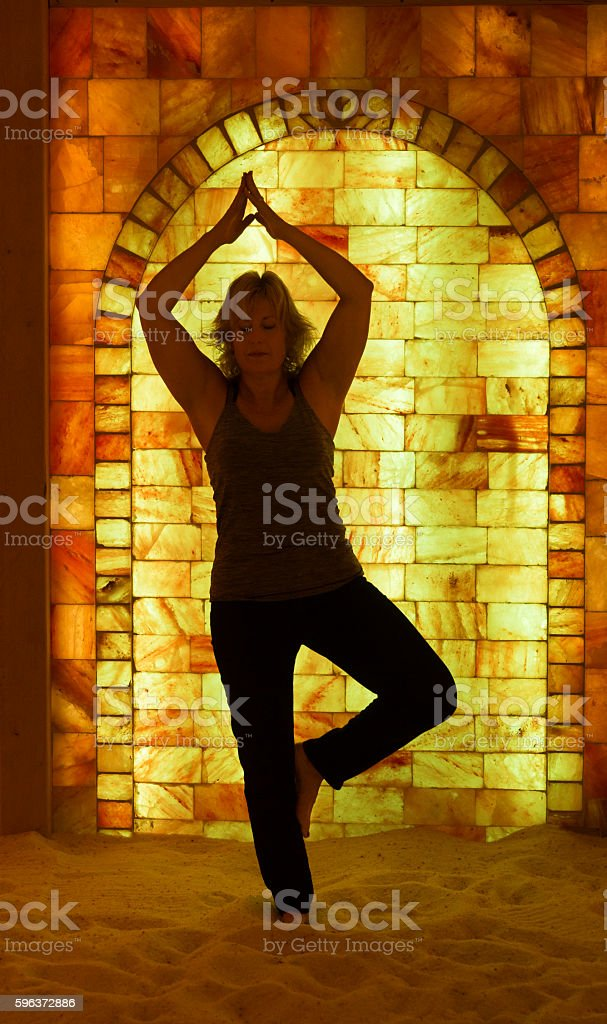 Tree pose in salt cave chamber stock photo