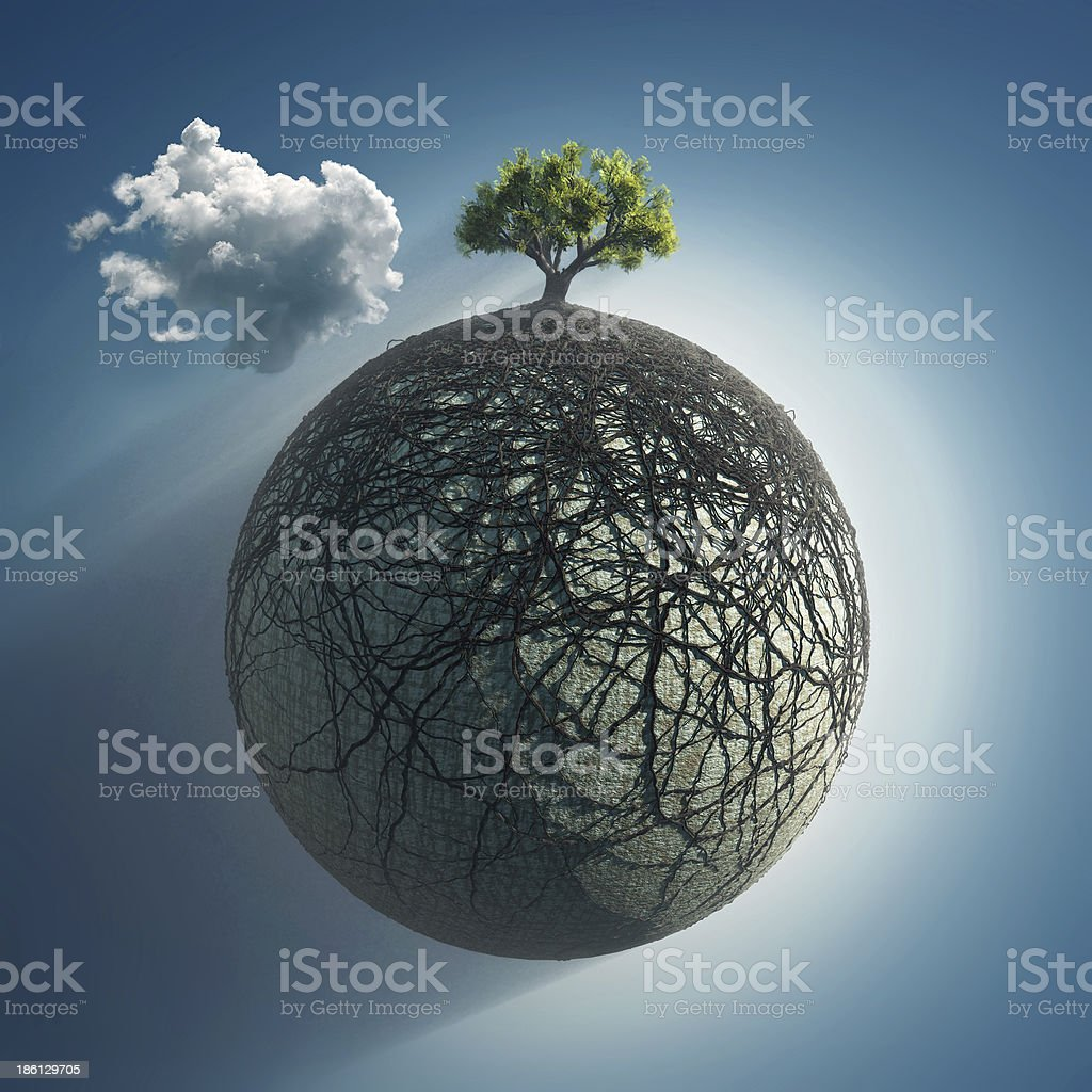 tree roots covering the planet stock photo