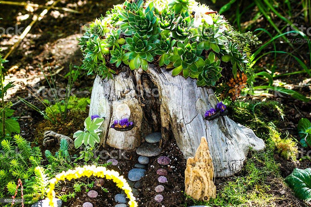 Tree Stump Fairyhouse with Succulents stock photo