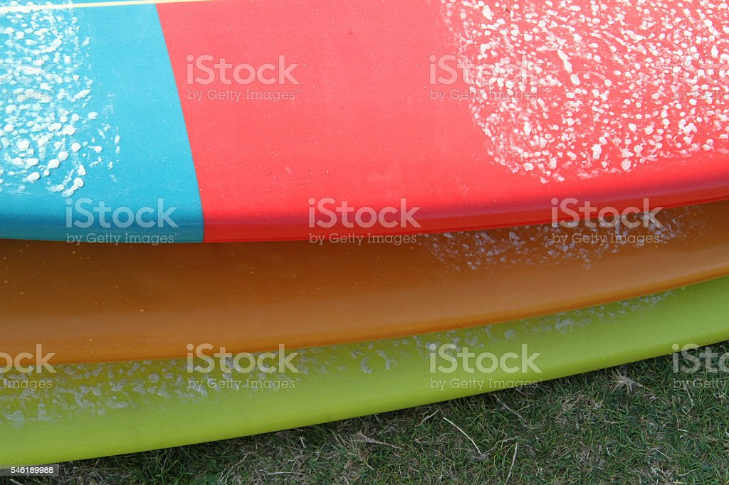 Tree surfboard on each other in different shapes and colors stock photo