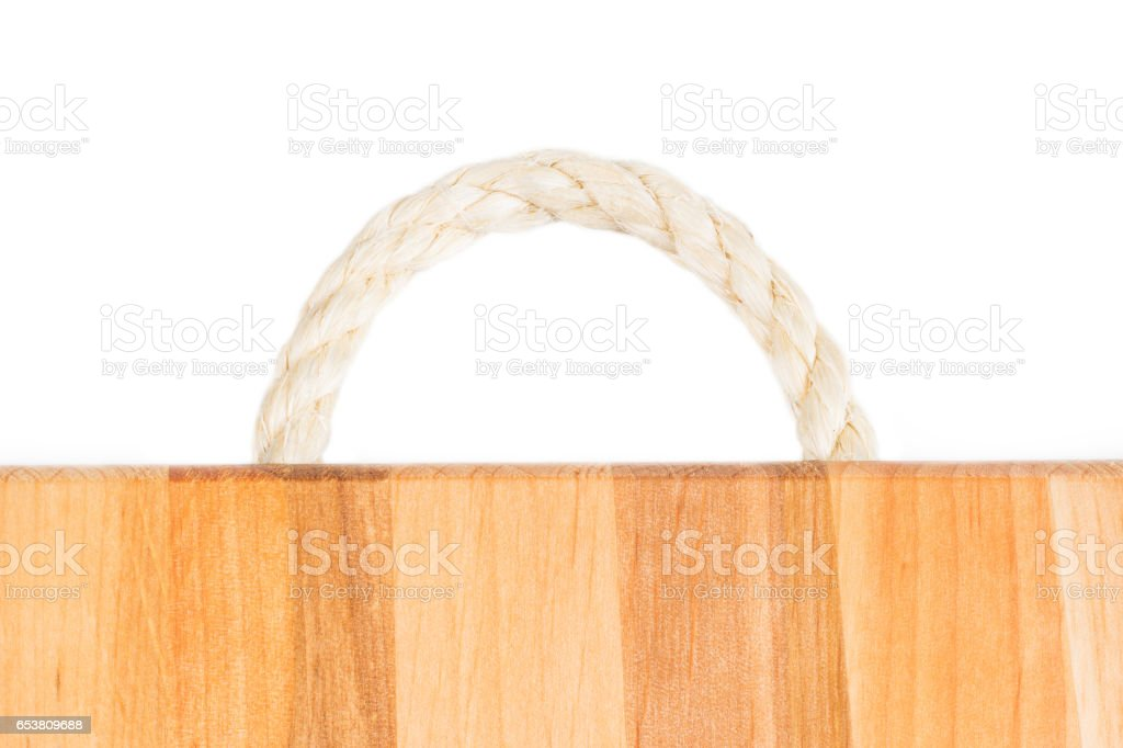Tree texture. Timber light natural pattern. Wood grain background. Rope handle wooden cutting board. stock photo