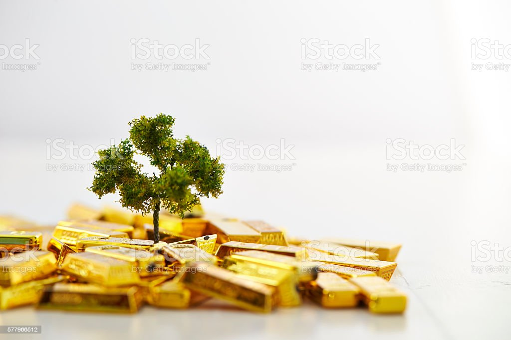Tree with gold bars stock photo