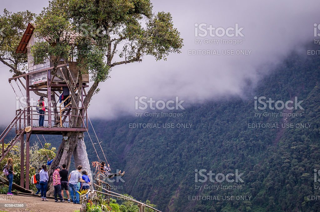 Treehouse giant swing in the Andes in Banos Ecuador stock photo