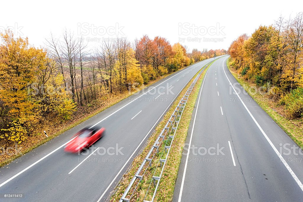 Treelined highway in autumn stock photo