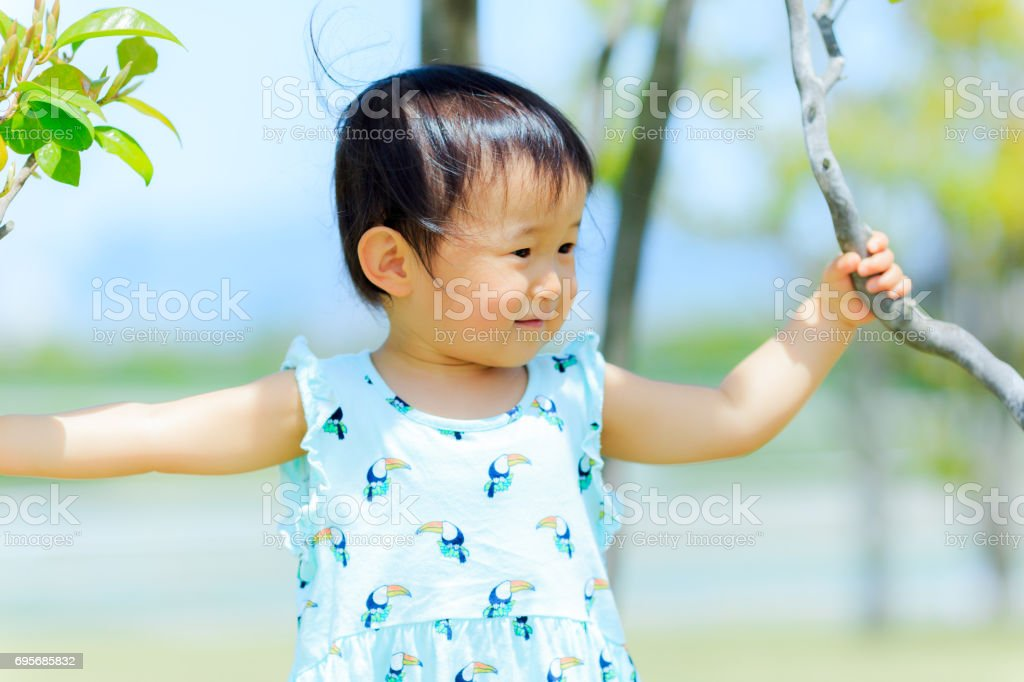 trees and cute kids stock photo