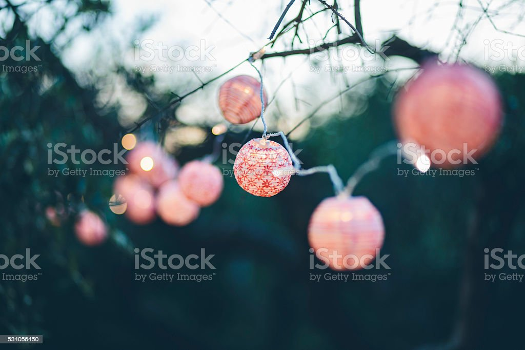 trees decorated with colorful lanterns stock photo