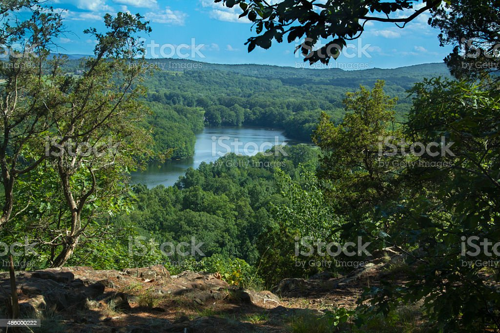 Trees framing Hart Ponds below ridge of Ragged Mountain, Connect stock photo