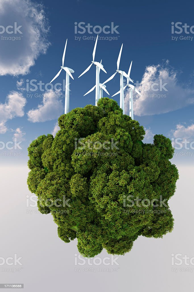 Trees in the sky with windmills on top signifying wind power royalty-free stock photo