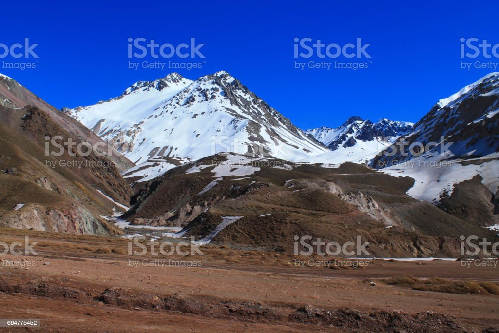 trek through a valley with high glaciers stock photo