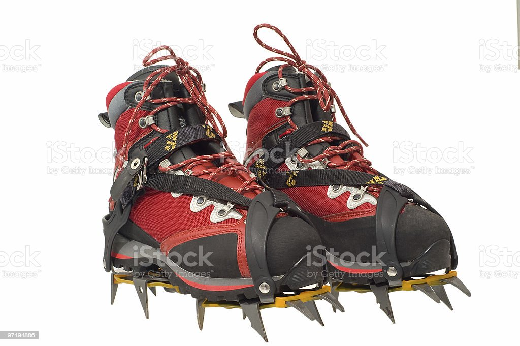 Treking boots with ther crampons stock photo