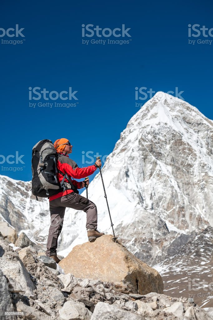 Trekker approaching PumoRi mountain in Khumbu valley on a way to Everest Base camp stock photo