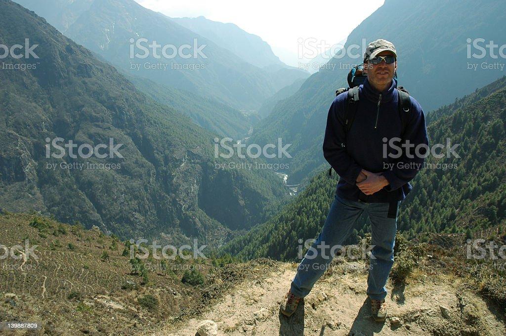 Trekker in the Himalaya royalty-free stock photo
