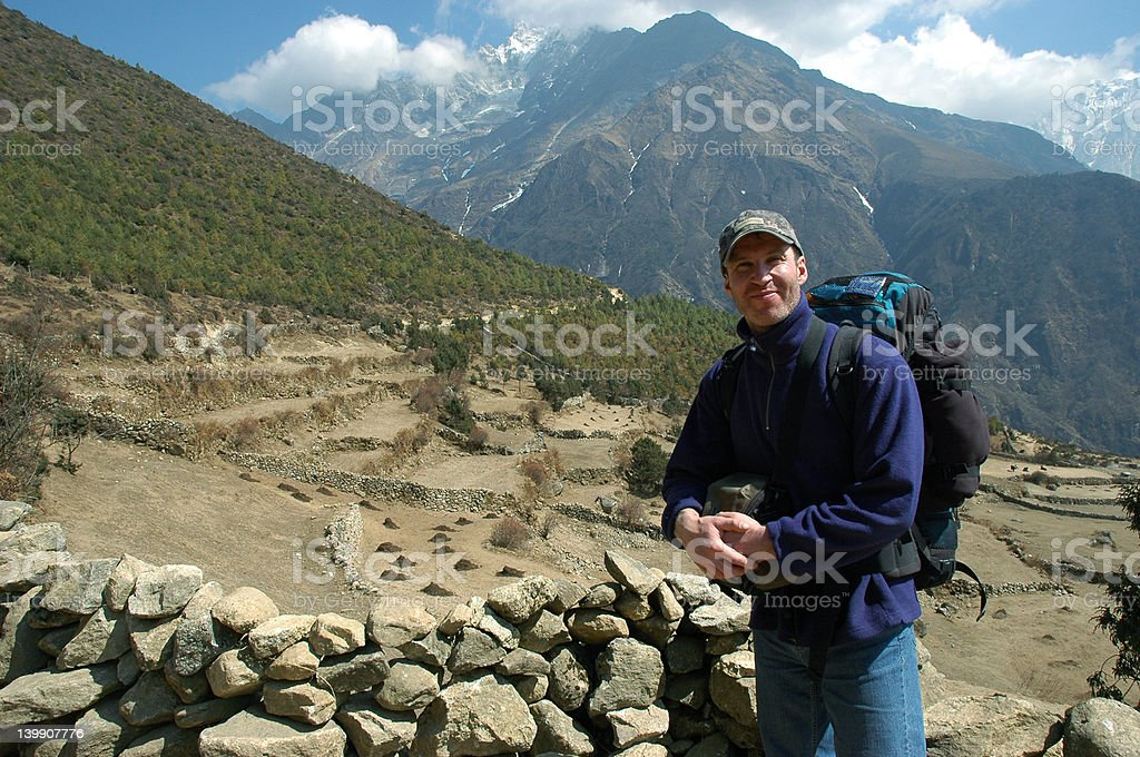 Trekker in the Himalaya royalty-free stock photo