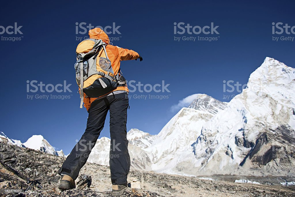 Trekker pointing at Mount Everest royalty-free stock photo