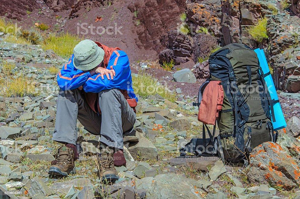 Trekker resting in height mountain stock photo