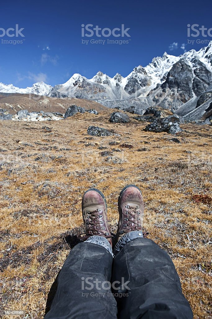 Trekker resting in Himalayas royalty-free stock photo