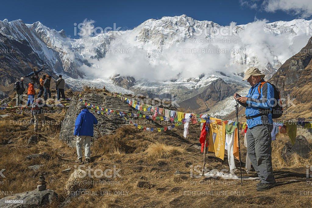Trekkers at Annapurna Base Camp under mountain peaks Himalayas Nepal royalty-free stock photo