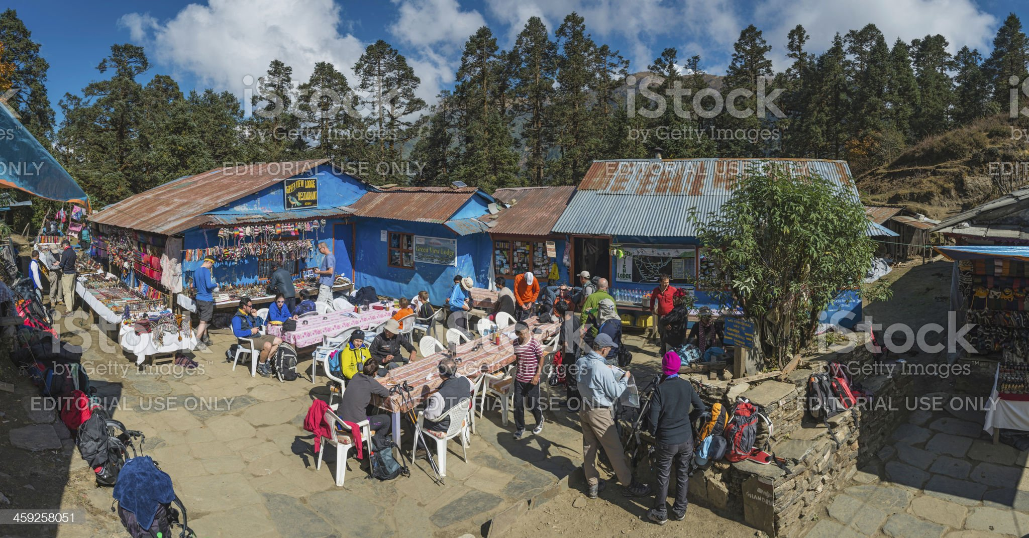 Trekkers at crowded colourful teahouse lodges Himalayas Nepal royalty-free stock photo