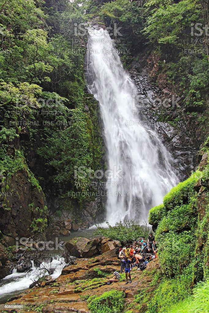 Trekkers at Mynapi Waterfall in Goa stock photo