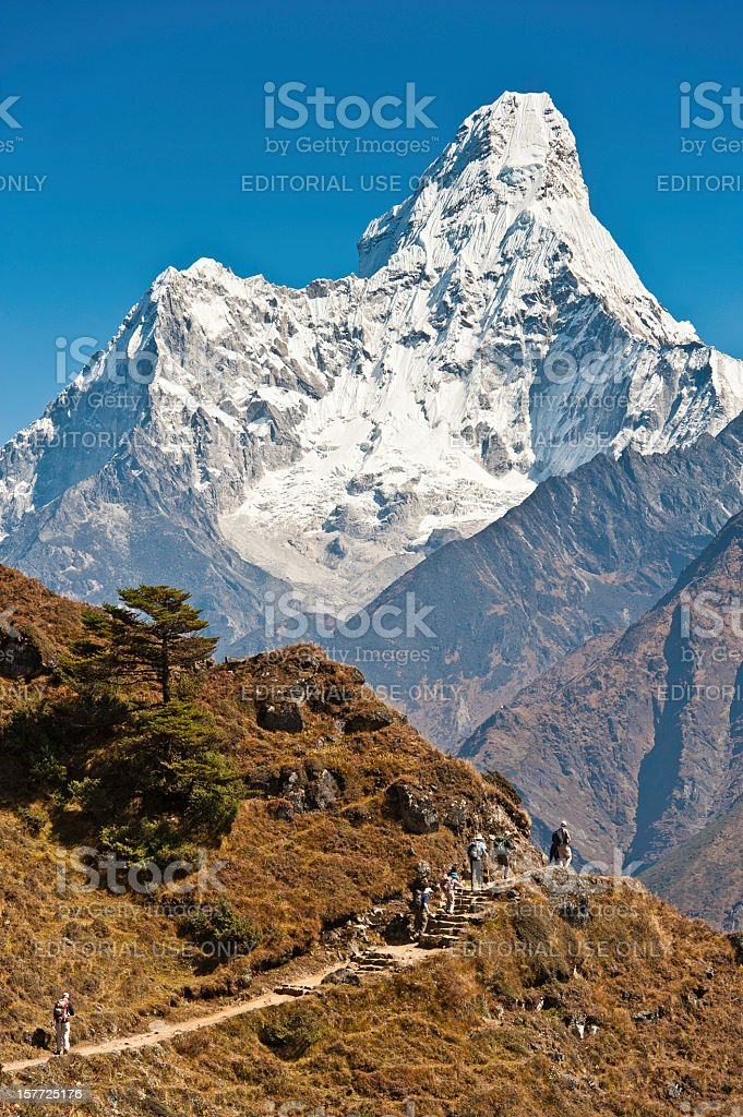 Trekkers hiking Everest Base Camp trail Ama Dablam Himalayas Nepal stock photo