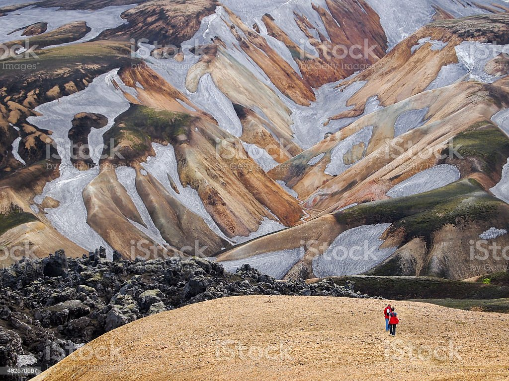 trekkers on the lava field at Landmannalaugar, Iceland stock photo