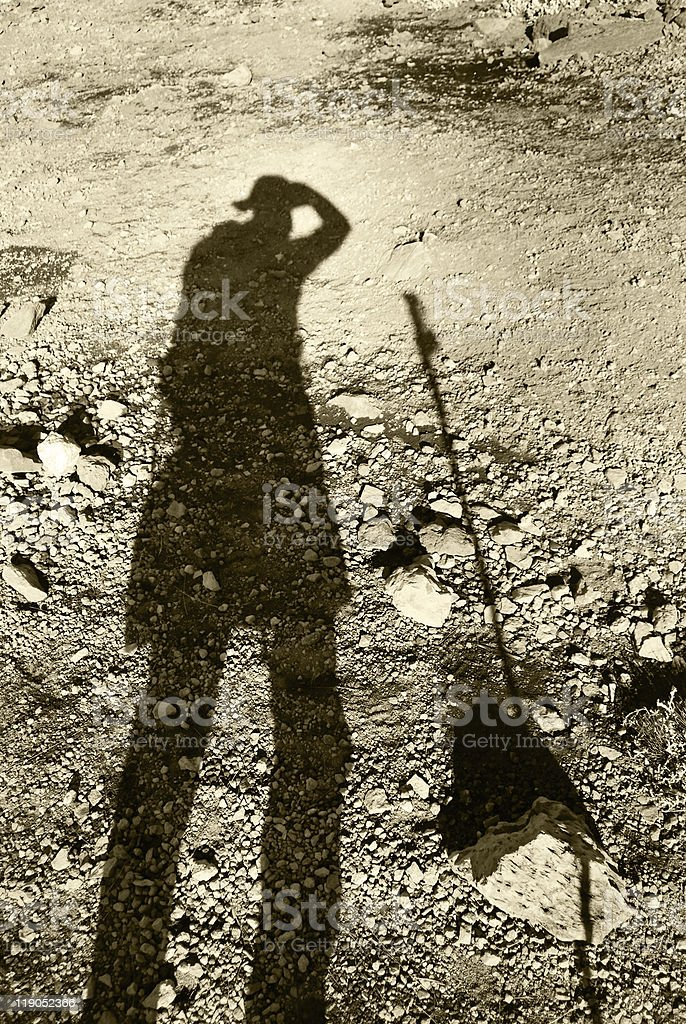 Trekkers shadow on the scree and gravel of Mt Kilimanjaro stock photo