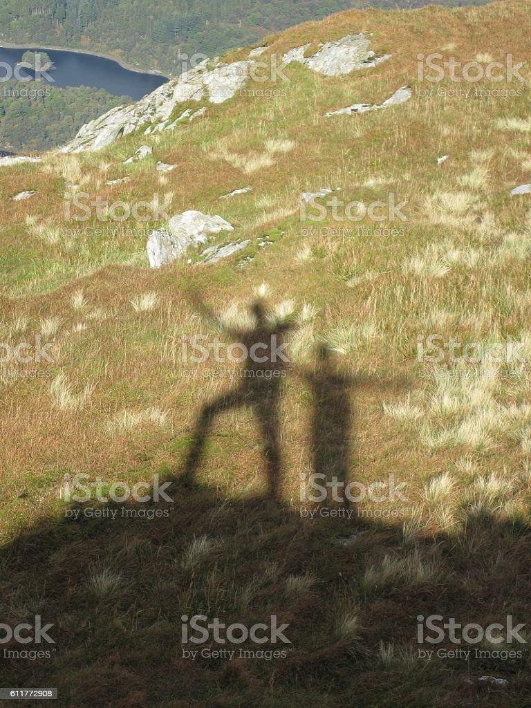 Trekkers Shadows from atop of Ben Venue, Scotland stock photo