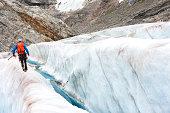 Trekking among crevasses on an icy glacier