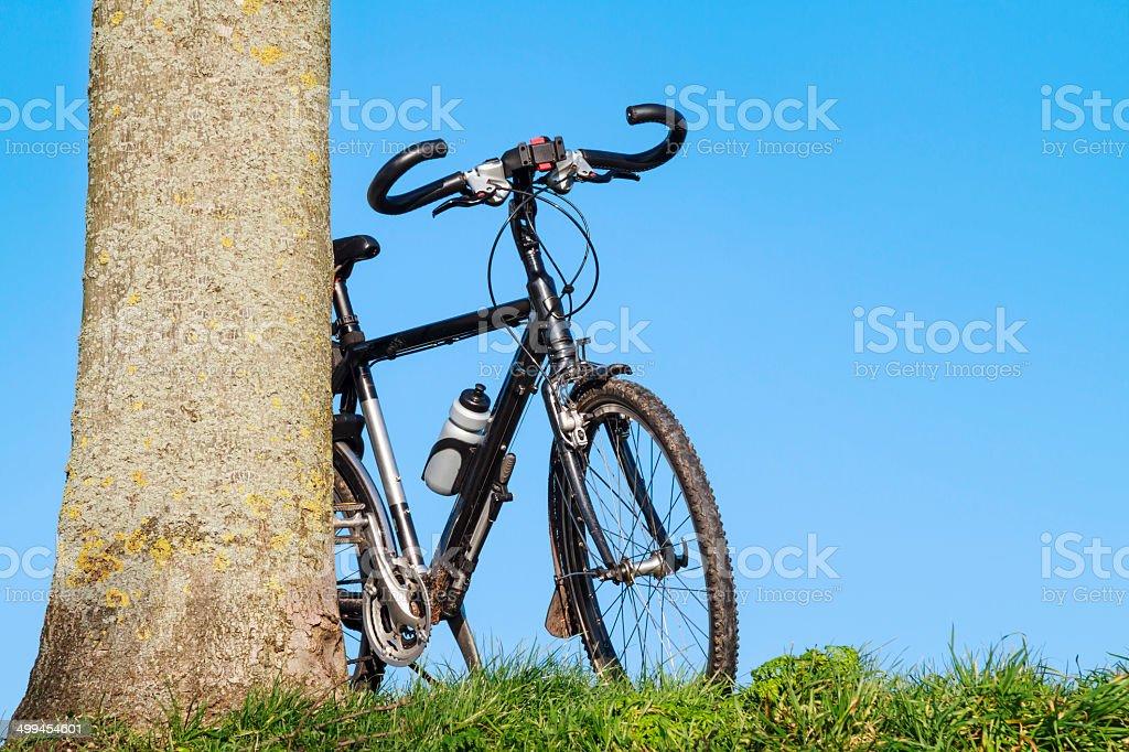 Trekking bike leaning stock photo