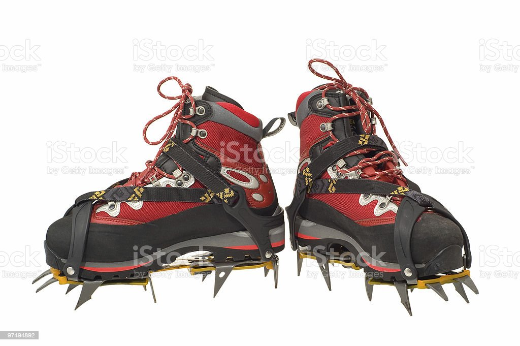 Trekking boots with the crampons stock photo