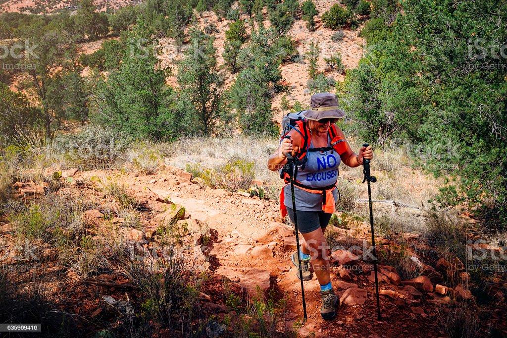 Trekking Her Way to the Top stock photo