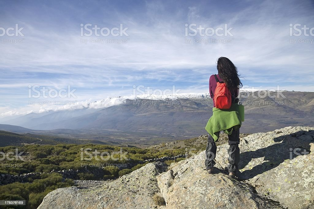 trekking hiking woman top mountain watching valley Gredos stock photo
