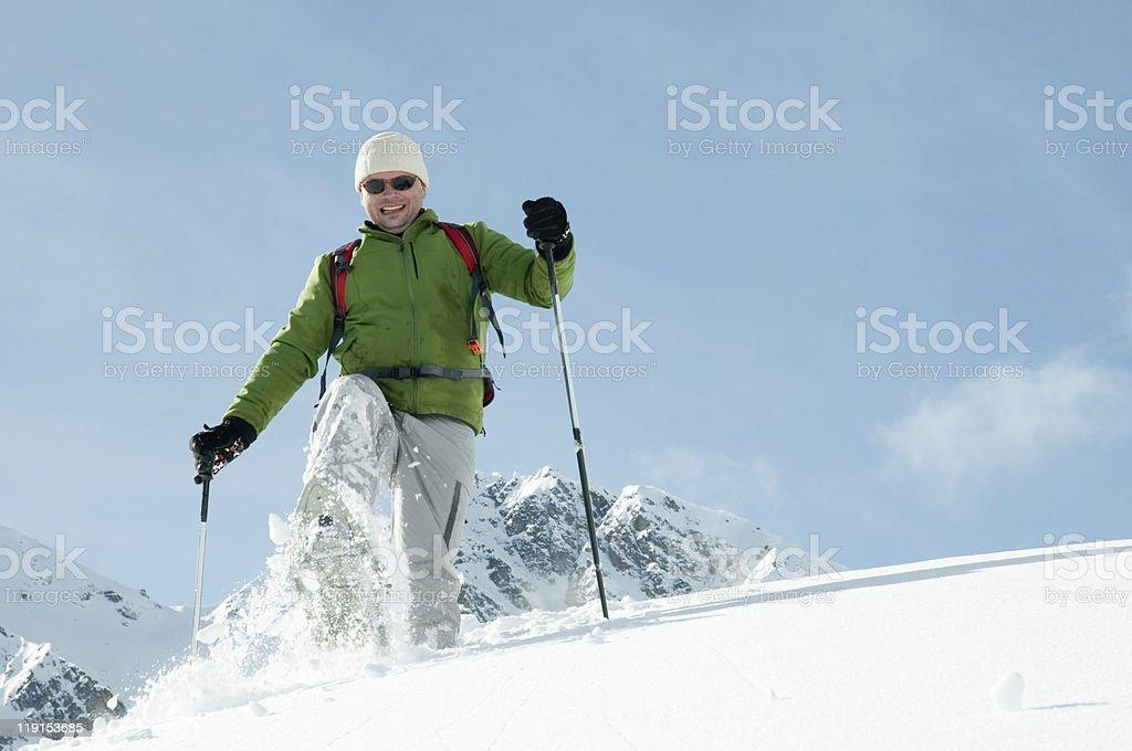 Trekking in snow royalty-free stock photo