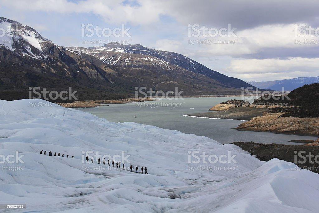 trekking on the perito moreno stock photo