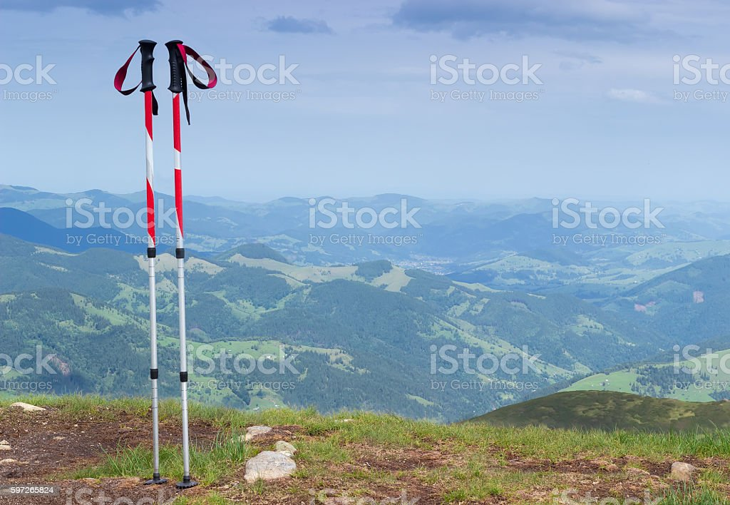 Trekking poles on a background of mountain landscape stock photo