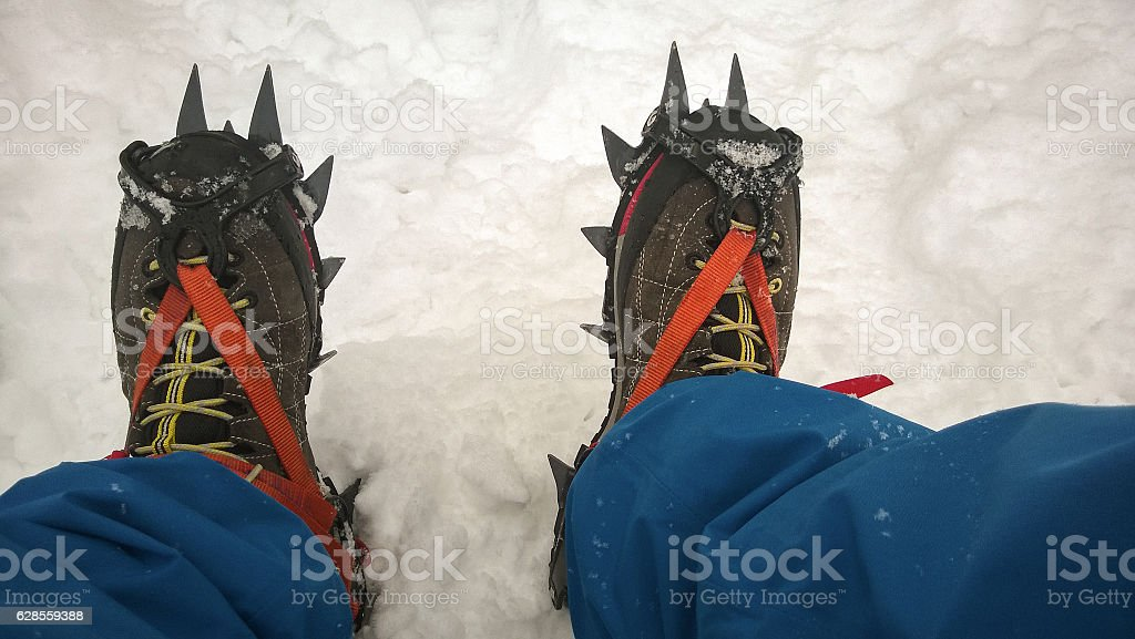 trekking shoes, crampons for mountaineering stock photo
