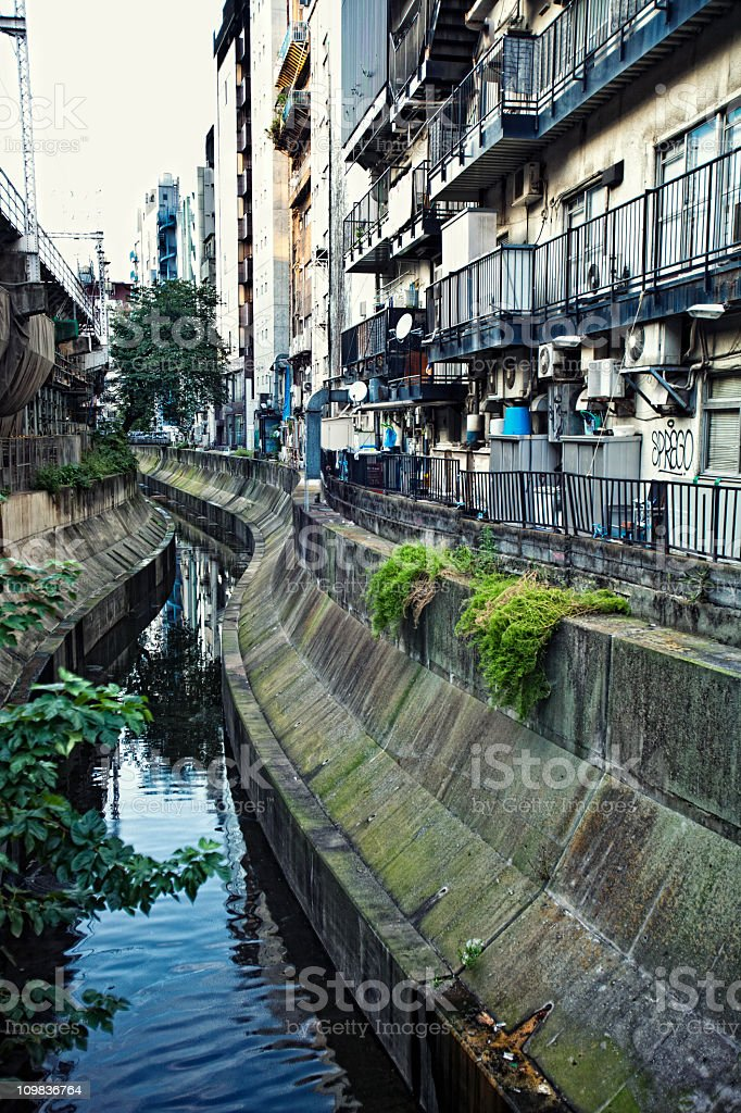 trench between railroad and houses stock photo