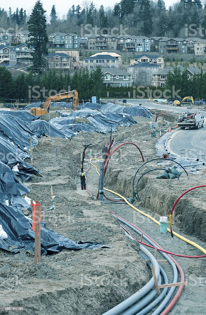 Trench containing gas and electric lines at housing developoment royalty-free stock photo