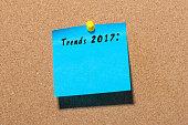 Trends 2017 written on blue sticker pinned at notice board