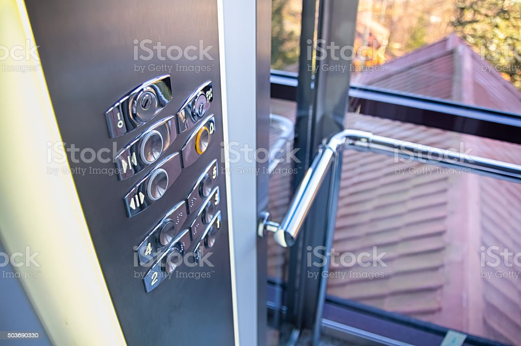 Trendy elevator with transparent walls stock photo