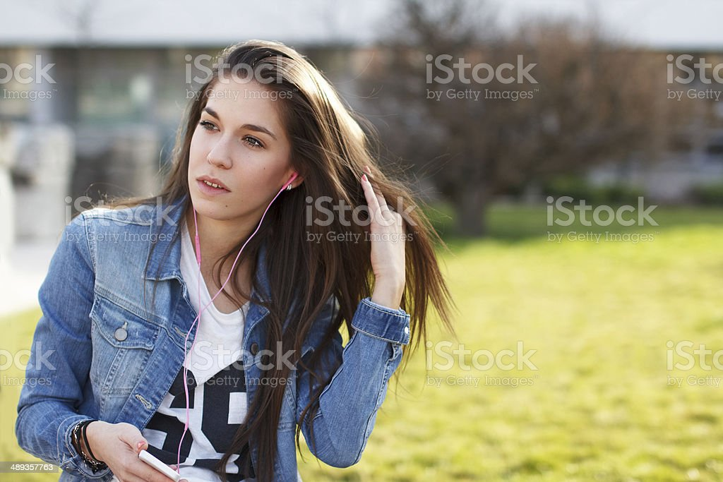 Trendy fashionable girl listening music royalty-free stock photo