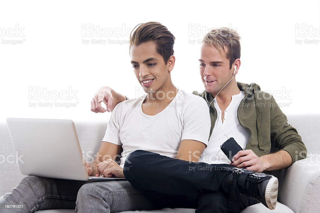 Trendy Gay Couple Surfing Internet Together royalty-free stock photo