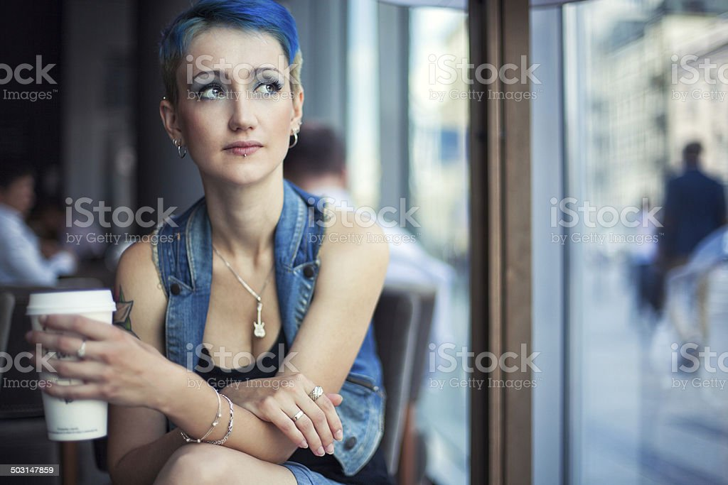 Trendy girl in a cafe stock photo