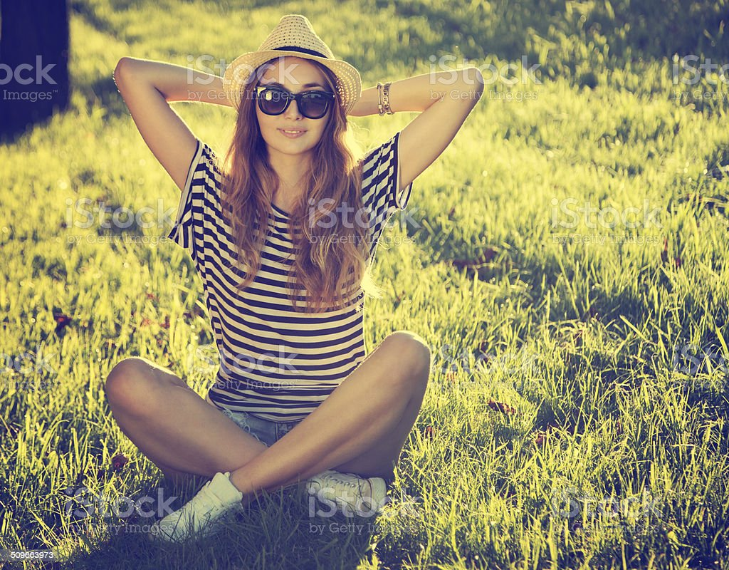 Trendy Hipster Girl Relaxing on the Grass stock photo