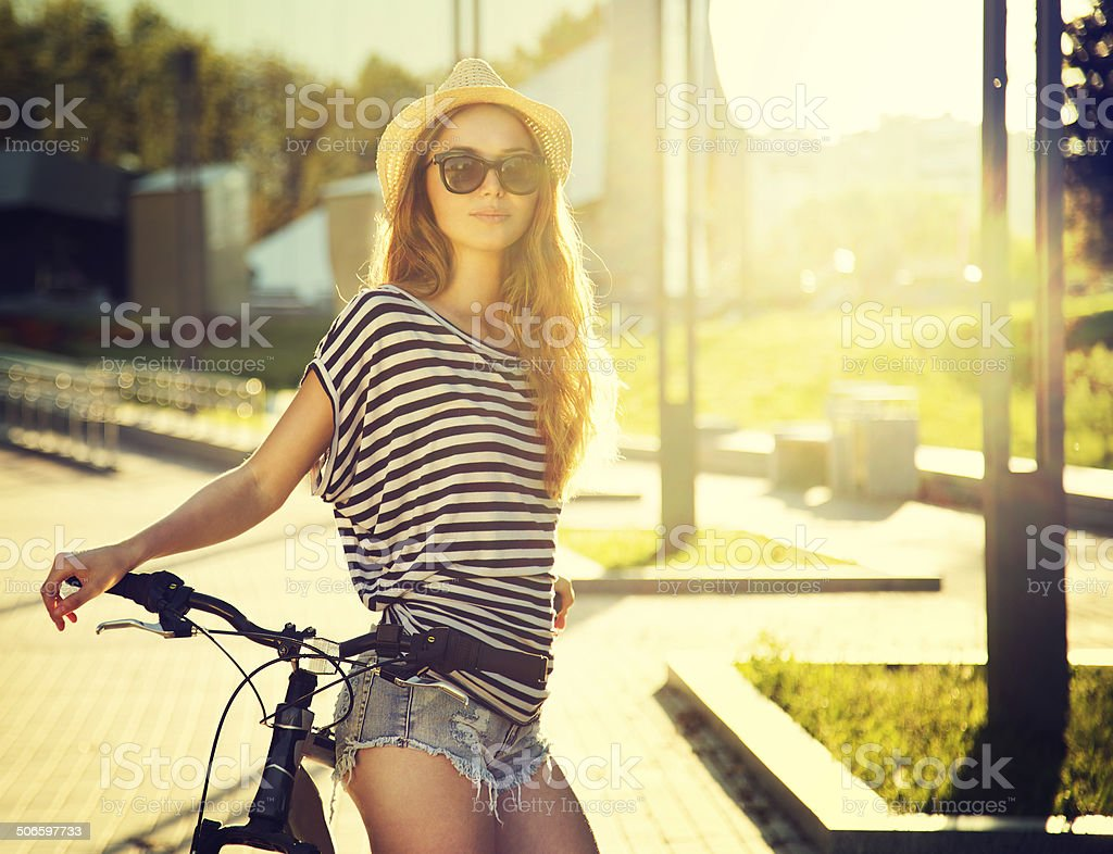 Trendy Hipster Girl with Bike in the City stock photo