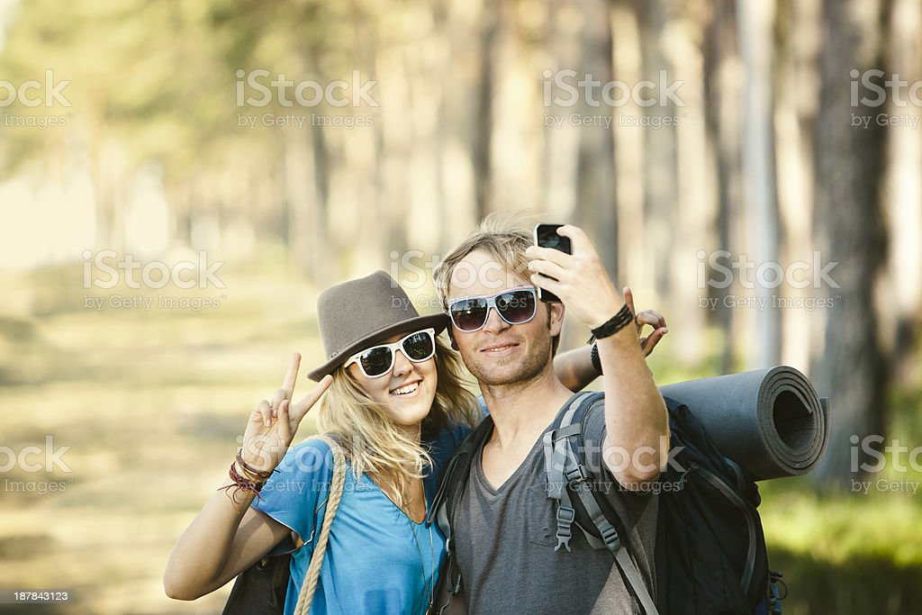 Trendy Hipsters Hiking and Taking Pictures royalty-free stock photo