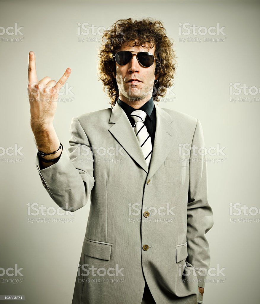 Trendy Man Giving Rock Sign stock photo